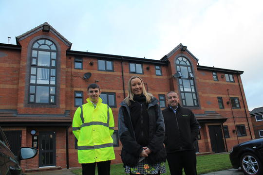 Ryan Whittaker, from Emanuel Whittaker, with Laura Derbyshire and Martin Parr, from Salix Homes, at the new-look Carmel Avenue.
