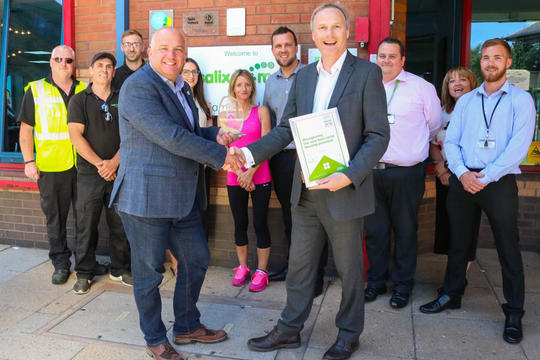 Keep Britain Tidy deputy chief executive Richard McIlwain presents the award to Lee Sugden, chief executive at Salix Homes.