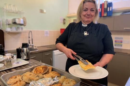 Rev Christine Threlfall serves up lunch in the new kitchen.