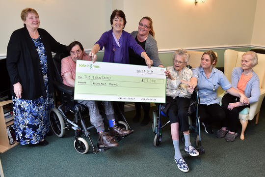 The Fountains residents and staff holding a cheque